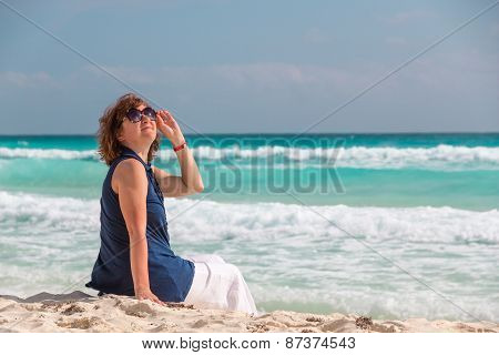 Woman On The Beach At Tropical Resort Looking Up To The Sky