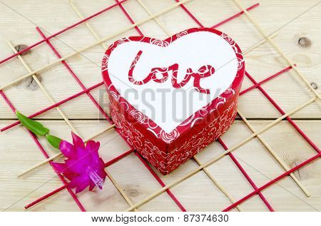 Heart Shaped Box Decorated With A Pink Flower