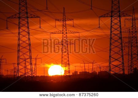 Electric Power Transmission Lines At Sunset.