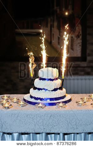 Beautiful Wedding Cake On A Table With Candles