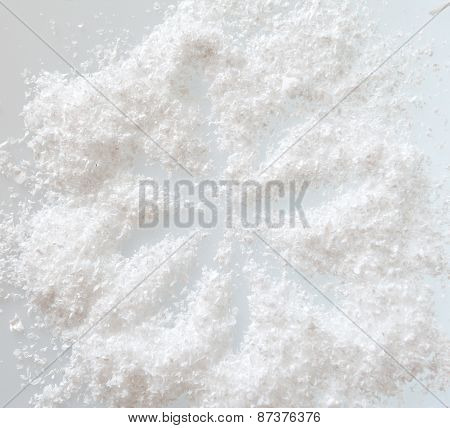 Artificial Snow On A White Background. Abstract