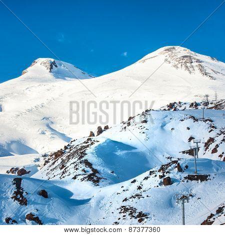 Two Peaks  Of Elbrus Mountain In Snow