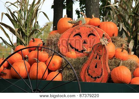 Fall scene of pumpkins and Jack-O-Lanterns