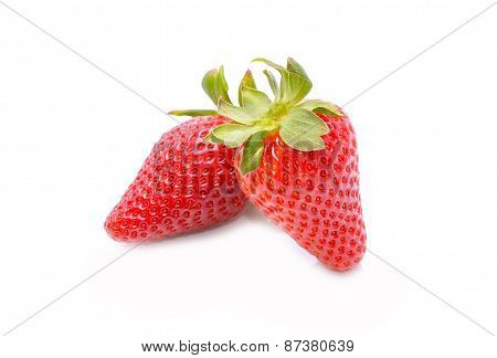 Two strawberries on white background