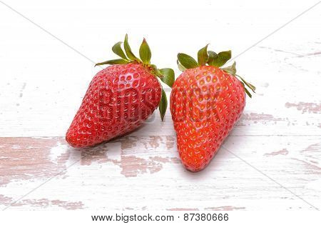 Strawberries on old white background
