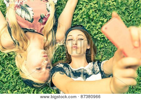 Two Girls Smiling At Camera