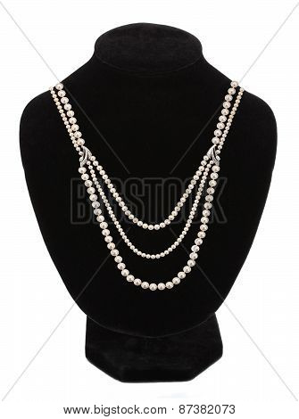 Pearl Necklace On Black Mannequin Isolated
