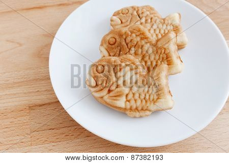 Japanese confectionery taiyaki fish cake wagashi on plate on table