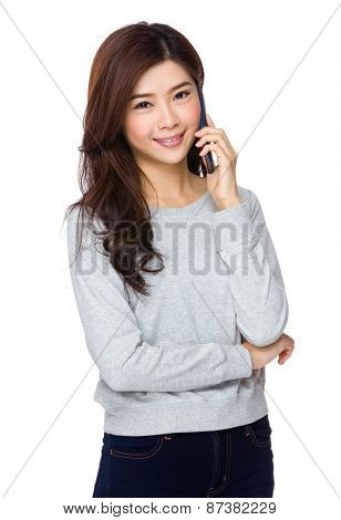 Young woman smiling and talking on her cell phone