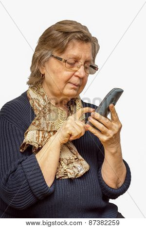 Positive Senior Woman In Glasses Dealing On The Phone Isolated Over White Background