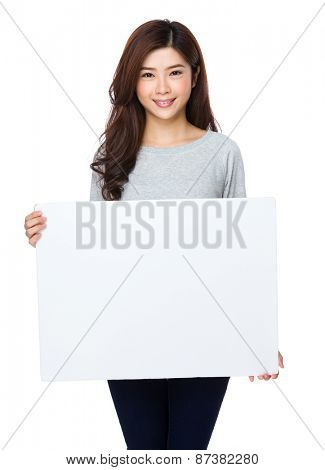 Pretty asian woman holding a blank whiteboard