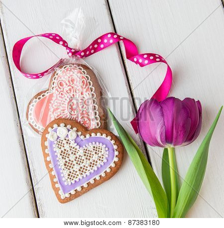 Heart Shaped Cookie Decorated With Ornaments And Flowers.