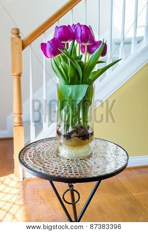 Purple Tulips In A Vase On Mosaic Table