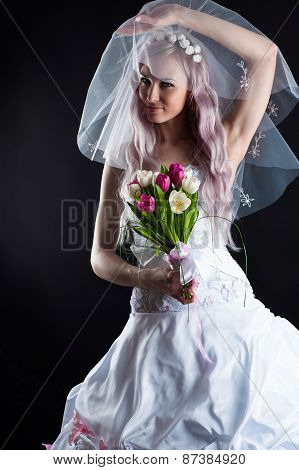 attractive woman in a wedding dress with a veil