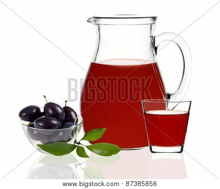 Plum Juice In A Glass And Carafe On A White Background