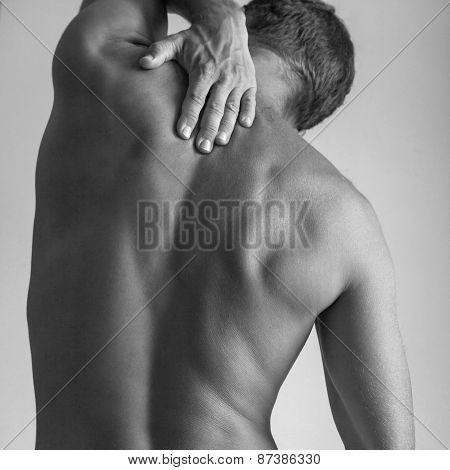 Back Of Strong Young Caucasian Man With Hand