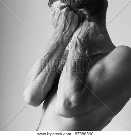 Young Caucasian Man Hides Behind His Strong Blocking Hands