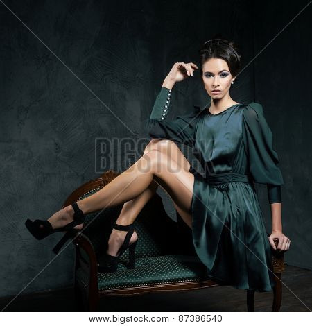 Gorgeous woman in vintage clothes over retro background