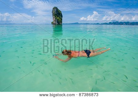 Woman swimming with snorkel, Andaman Sea, Thailand