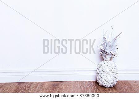 Fancy, white pineapple on the floor