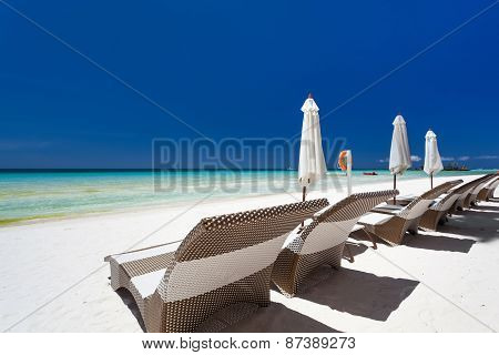 Sun Umbrellas And Beach Chairs On A Beautiful Island, Boracay