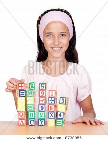 Little Girl With With Wooden Blocks Stacked