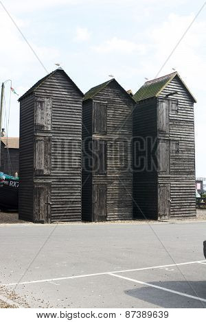 Old Wooden Fisherman Huts On Hastings Beach. England