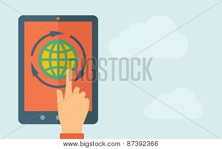 A hand is touching the screen of a tablet with globe icon. A contemporary style with pastel palette, light blue cloudy sky background. Vector flat design illustration. Horizontal layout with text