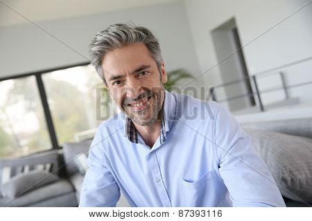 Portrait of handsome mature man with blue shirt