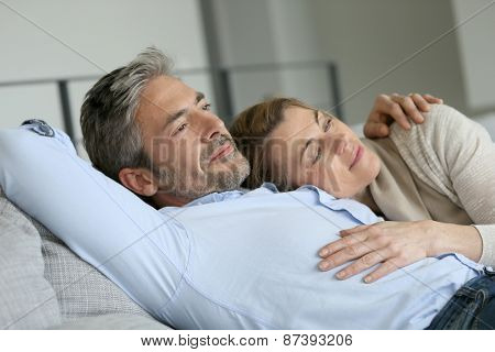 Mature couple relaxing in sofa, peaceful scene