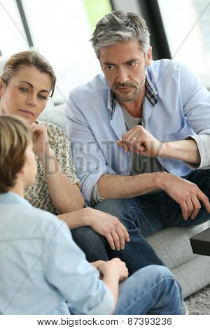 Parents having a talk with teenage boy