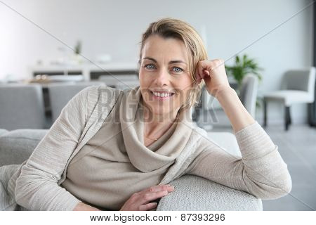 Portrait of mature smiling blond woman