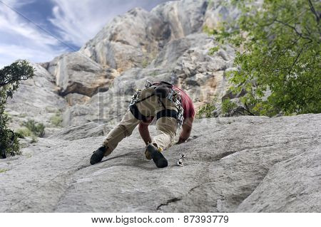 Climber On The Rock Wall