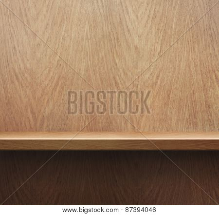 Empty bookshelf or shelf on wooden wall background
