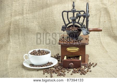White Tablecloth On The Table Or Burlap, Old Coffee Grinder, White Porcelain Cup ,croissants