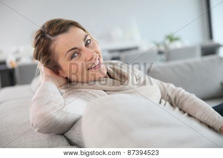 45-year-old woman relaxing in sofa