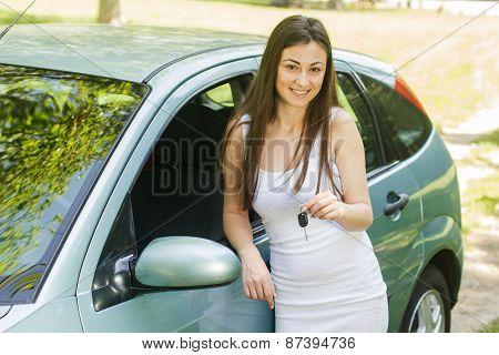 Woman Showing Keys Of New Car