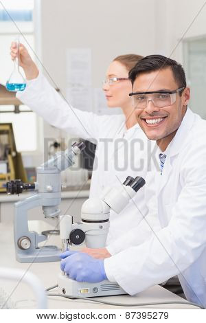 Scientists examining blue precipitate in the laboratory