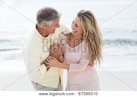 Happy couple having fun together at the beach