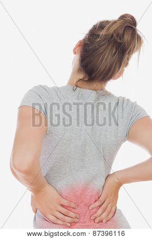 Rear view of woman suffering from backache against white background