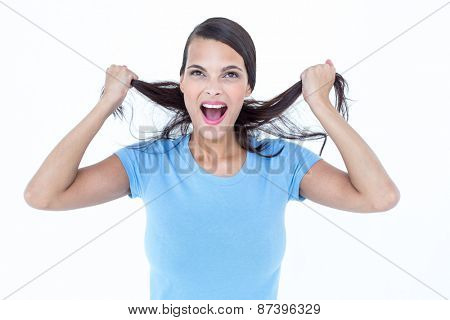 Furious woman pulling her hair on background