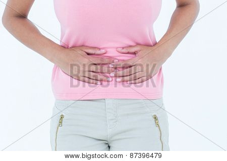 Woman suffering from stomach ache on white background