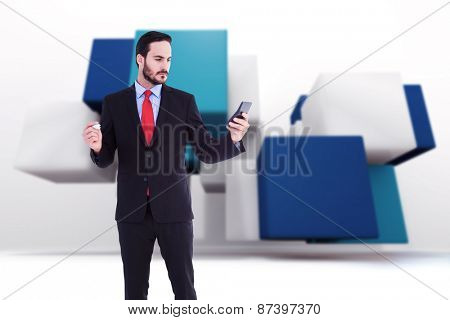 Handsome businessman texting on phone against abstract background