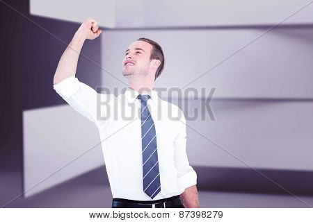 Businessman cheering with clenched fist against abstract room