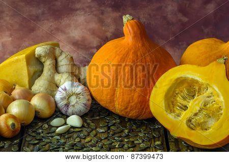 Pumpkin vegetable soup ingredients - pumpkin, ginger, parmesan, onions, garlic, pumpkin seeds