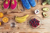 picture of composition  - Running shoes and healthy food composition on a wooden table background - JPG