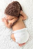 foto of knitting  - Newborn baby wearing a knitted hat and knitted diaper cover - JPG