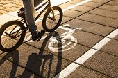 image of exercise bike  - Bike path with a biker and symbol of bike.