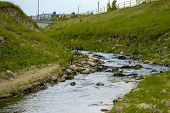 foto of sewage  - Sewage Water flowing into the river outdoors - JPG