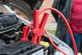 image of dead-line  - car battery clamped with red jumper cable to recharge the power - JPG